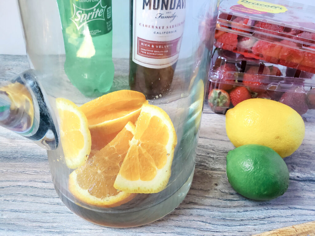 oranges in pitcher for sangria