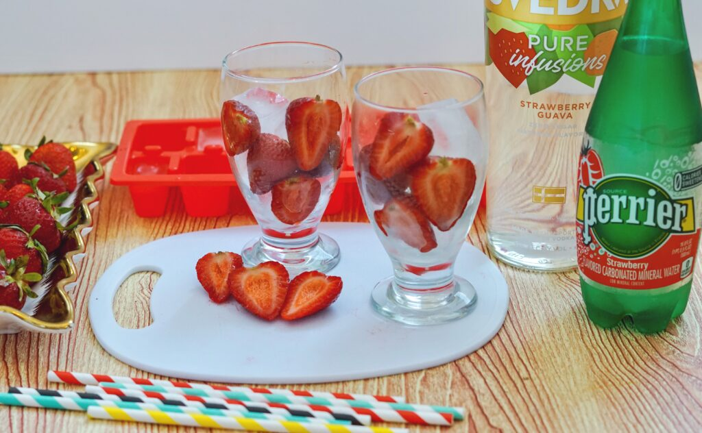 cut up strawberries in glass for guava cocktail
