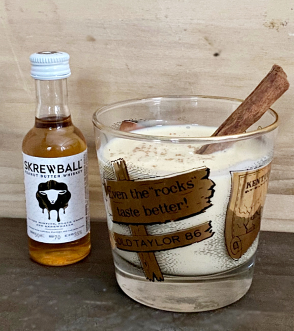peanut butter whisky bottle with glass