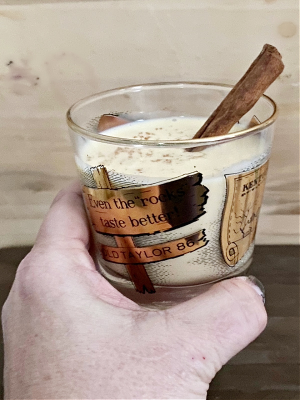 spiked eggnog with cinnamon stick