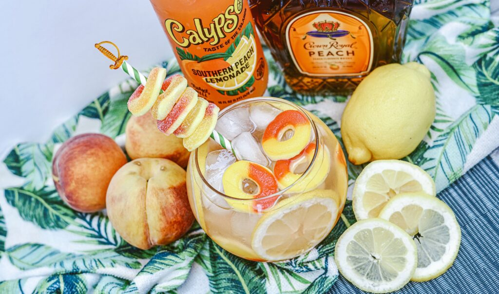 overhead view of crown royal peach whiskey fish bowl recipe