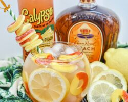 Crown Royal Peach Whiskey Drink in a fish bowl with leaf towel on table