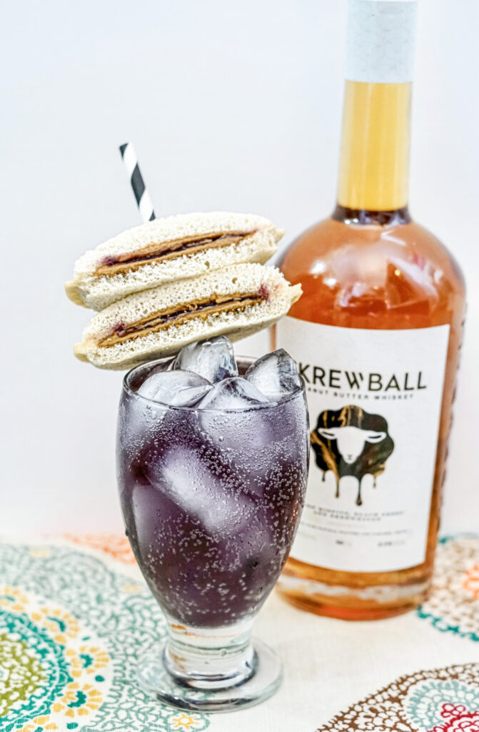 Peanut Butter & Jelly Whiskey Cocktail on counter with peanut butter whiskey
