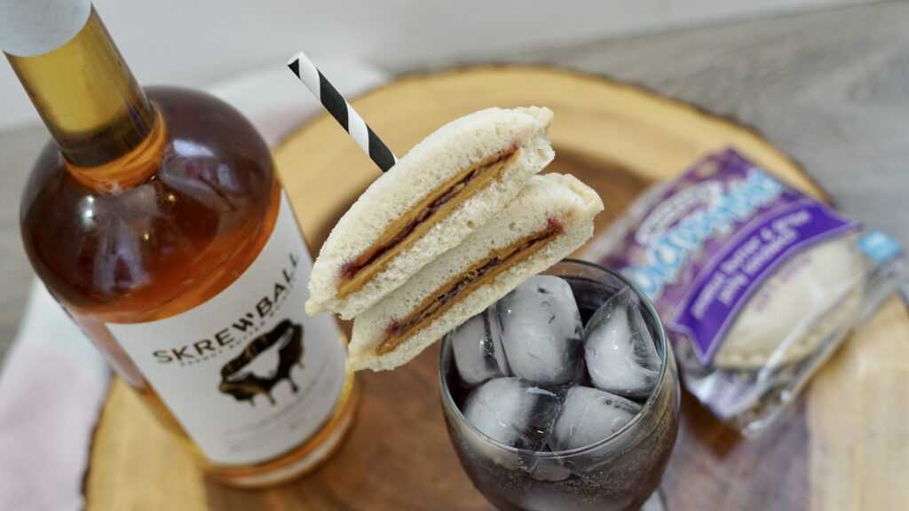 peanut butter & jelly whiskey cocktail with sandwich
