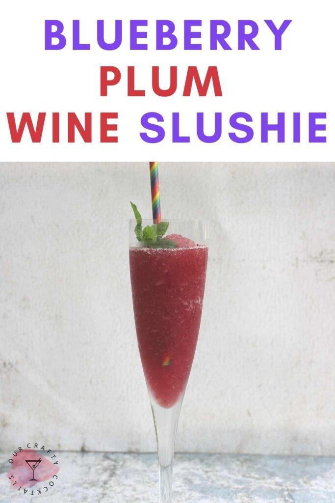 wine glass with blueberry plum wine slushie