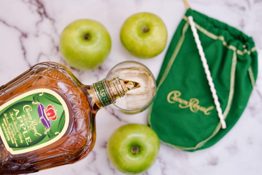 pouring crown royal apple into whiskey glass